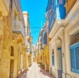 Enjoy old Birgu, Malta. Get lost in historical living quarters of medieval Birgu Vittoriosa with scenic edifices, decorated with wooden shutters, doors and stock photos
