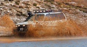 Enjoy que conduz na lama Imagem de Stock
