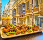 Rabbit in red wine, Valletta, Malta. Enjoy the rabbit, stewed in red wine with beans, herbs and spices in the popular restaurant of Strait street, Valletta royalty free stock photo