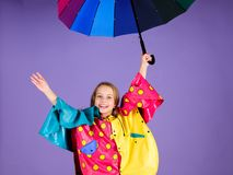 Enjoy rainy weather with proper garments. Waterproof accessories for children. Waterproof accessories make rainy day. Cheerful and pleasant. Kid girl happy hold royalty free stock photo