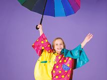 Enjoy rainy weather with proper garments. Waterproof accessories for children. Waterproof accessories make rainy day. Cheerful and pleasant. Kid girl happy hold royalty free stock photos