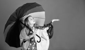 Enjoy rainy weather with proper garments. Waterproof accessories make rainy day cheerful and pleasant. Kid girl happy. Hold colorful umbrella wear waterproof stock photos