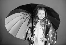 Enjoy rainy weather with proper garments. Waterproof accessories manufacture. Waterproof accessories make rainy day. Cheerful and pleasant. Kid girl happy hold royalty free stock photo