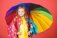 Enjoy rainy weather with proper garments. Waterproof accessories manufacture. Waterproof accessories make rainy day. Cheerful and pleasant. Kid girl happy hold stock photo