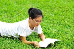 Enjoy reading book on grass Royalty Free Stock Images