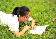Enjoy reading on grass Stock Photos