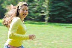 Enjoy it - running teenager Stock Images