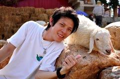 Enjoy in sheep farm. The asian boy with sheep, Thailand farm royalty free stock photography