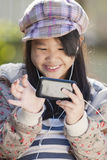 Enjoy Smart phone. Cute asian girl play game from Smart phone Stock Photo