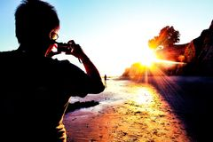 Enjoy summer at the beach. Taking picture of the beach sunset in summer Stock Image