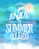 Enjoy the summer holidays card on a sea water blue backdrop. Stock Photos