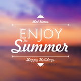 Enjoy Summer Holidays text over defocused sunset background vect Royalty Free Stock Images