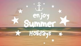 Enjoy summer holidays. Text with sea in background stock video footage