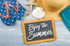 Enjoy the Summer. Message on a chalkboard - Enjoy the Summer Royalty Free Stock Photos