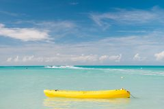 Enjoy summer. Spend vacation exciting occupation st.johns antigua. Sea turquoise water yellow canoe near beach. Extreme. Entertainment tropical vacation. Best Stock Photos