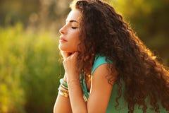 Enjoy in sun. Young curly hair woman enjoy in summer sun Royalty Free Stock Photo