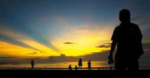 Enjoy sunset. At Kuta Beach in Bali, Indonesia Royalty Free Stock Photo