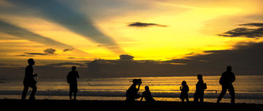 Enjoy sunset at Kuta Beach. In Bali, Indonesia Stock Photos