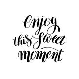 Enjoy this sweet moment hand written lettering motivational quot Stock Photos