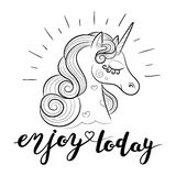 Enjoy Today. Hand drawn typography poster with cute unicorn. Stock Photos