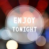 Enjoy tonight on colorful bokeh background Royalty Free Stock Images