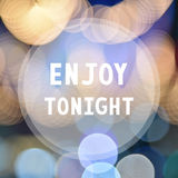 Enjoy tonight on colorful bokeh background.  Royalty Free Stock Photo