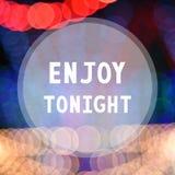 Enjoy tonight on colorful bokeh background.  Stock Image