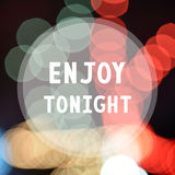 Enjoy tonight on colorful bokeh background.  Stock Image