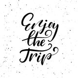 Enjoy the trip. Ink brush pen hand drawn phrase lettering design. Stock Images