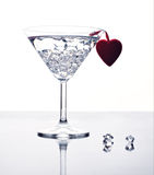 Enjoy valentine's day. A martini glass with ice and red heart, still life Royalty Free Stock Images