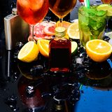 Enjoy a variety of specialty cocktails. Whiskey cocktail drinks in glasses. Cocktails garnished with ice cubes, fruit. And mint. Drink reception. Cocktail party stock image