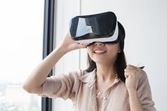 Enjoy vr headset. Asian woman wear vr headset and enjoy experience Royalty Free Stock Photos