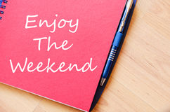 Enjoy the weekend write on notebook. Enjoy the weekend text concept write on notebook Royalty Free Stock Images