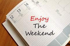 Enjoy the weekend write on notebook Stock Images