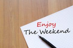 Enjoy the weekend write on notebook Stock Photos