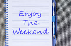 Enjoy the weekend write on notebook Royalty Free Stock Image