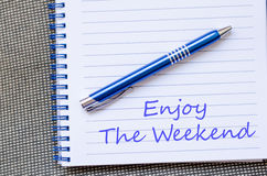 Enjoy the weekend write on notebook. Enjoy the weekend text concept write on notebook Royalty Free Stock Image