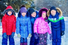 Enjoy winter day. Happy family enjoy sunny winter day. Snow. Winter clothes. Winter activity Stock Image
