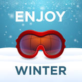 Enjoy winter outside red ski goggles. Cluse-up and snow Royalty Free Stock Photography