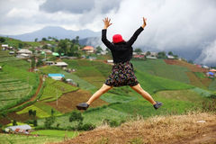 Enjoy women at farmland. Woman enjoy jumping at farmland view stock image