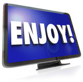 Enjoy Word HDTV Television Program Entertainment. The word Enjoy on a HDTV screen to illustrate television program or show viewing in a home theatre such as Stock Images