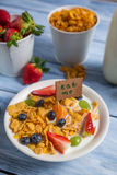 Enjoy your breakfast with cornflakes and fruits Stock Image