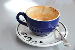 Enjoy (reflection of word 'enjoy' shown on cup). Enjoy your coffee break, enjoy your life Stock Photo