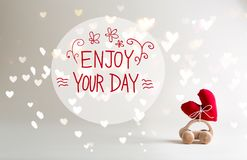 Enjoy Your Day message with toy car carrying a heart. Cushion stock photos