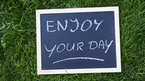 Enjoy your day written Stock Image