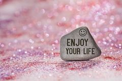 Enjoy your life engrave on stone stock images