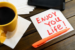Enjoy your life writing on white napkin Royalty Free Stock Photos