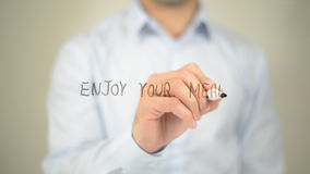 Enjoy Your Meal , man writing on transparent screen Stock Images