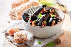 Enjoy your mussels with coriander and chili peppers royalty free stock photo