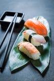 Enjoy your Nigiri sushi with octopus, prawn and salmon Royalty Free Stock Photos